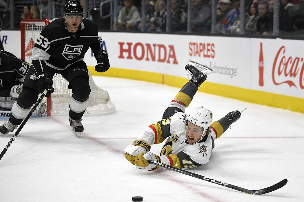 Vegas Golden Knights left wing Brendan Leipsic, right, falls as he passes the puck while under pressure from Los Angeles Kings defenseman Kevin Gravel during the first period of an NHL hockey game ...