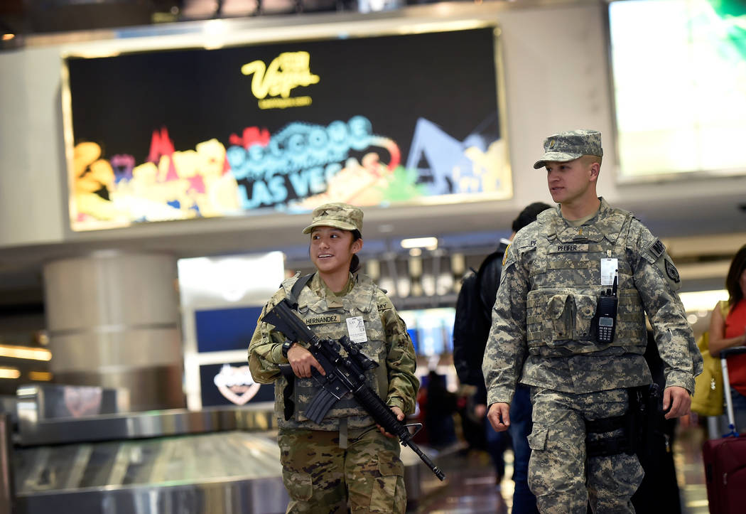 Pvt. Kimberly Hernandez, left, and 2nd Lt. Drake Pfeifer of the 72nd Military Police company patrol Terminal 1 baggage claim at McCarran International Airport Friday, Dec. 29, 2017, in Las Vegas.  ...
