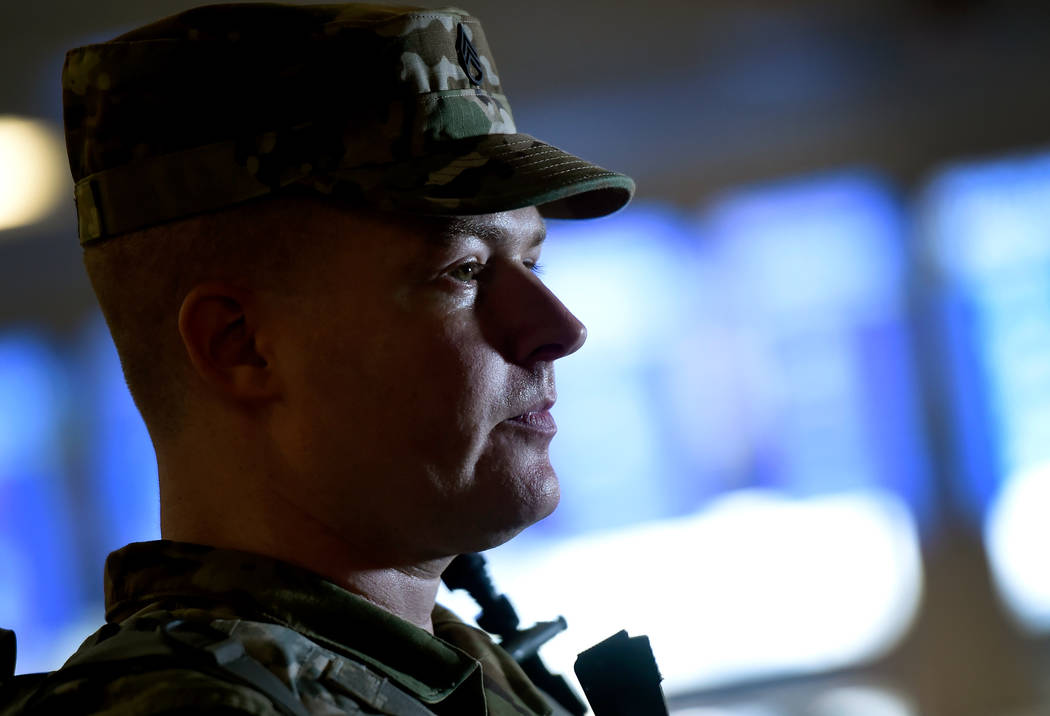 Staff Sgt. Kris Hayman of the Nevada Army National Guard looks on as he patrols the Terminal 1 baggage claim at McCarran International Airport Friday, Dec. 29, 2017, in Las Vegas. Over 300 soldier ...