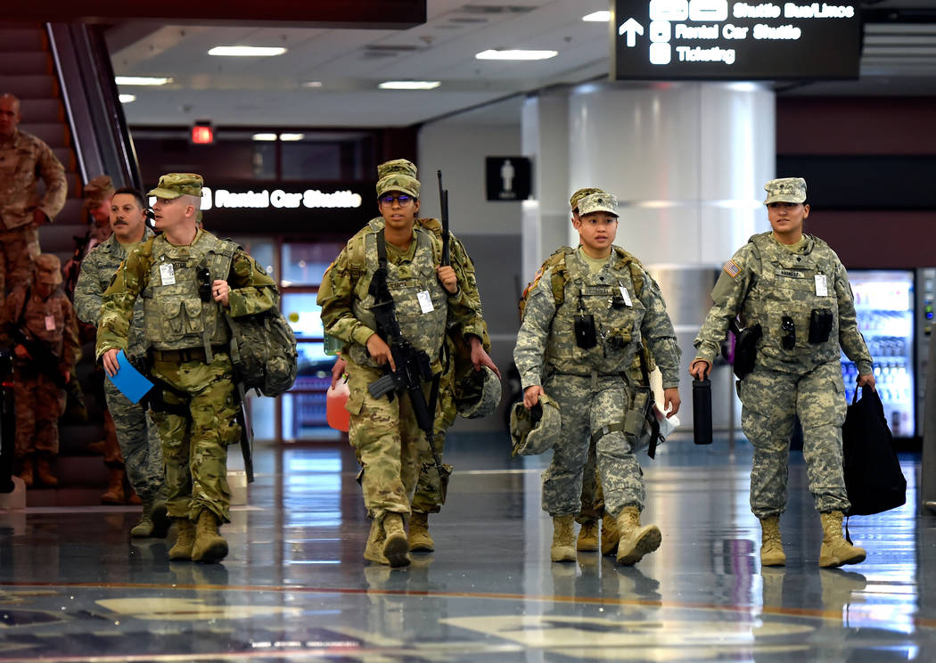 Members of the Nevada Army National Guard arrive to begin their patrol at McCarran International Airport Friday, Dec. 29, 2017, in Las Vegas. Over 300 soldiers and airmen from the Nevada Army Nati ...