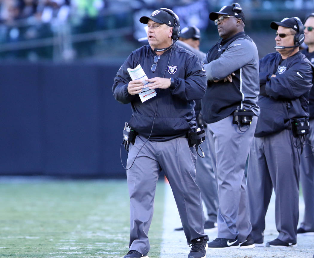 Oakland Raiders defensive coordinator John Pagano coaches from the sideline during the first half of a NFL game against the New York Giants in Oakland, Calif., Sunday, Dec. 3, 2017. Heidi Fang Las ...