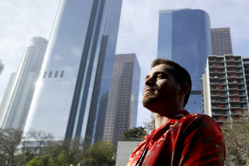 Elias Zaldivar, who has a medical marijuana prescription poses for a picture in Los Angeles.  (AP Photo/Chris Carlson)