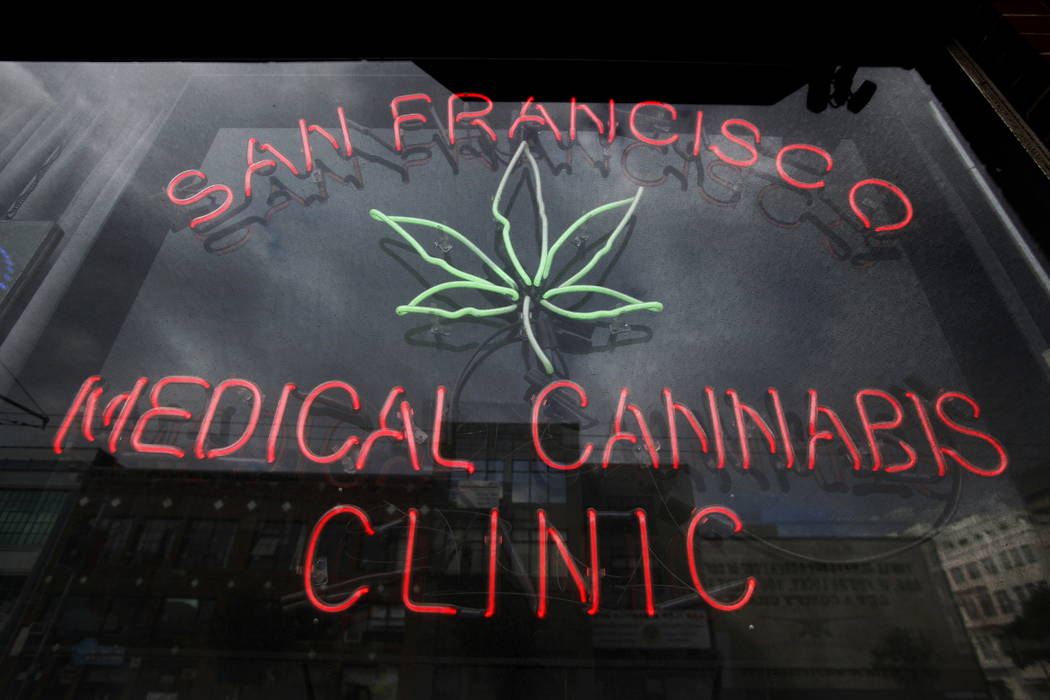 A neon sign at the entrance to the San Francisco Medical Cannabis Clinic in San Francisco is seen in 2009. (AP Photo/Eric Risberg, File)