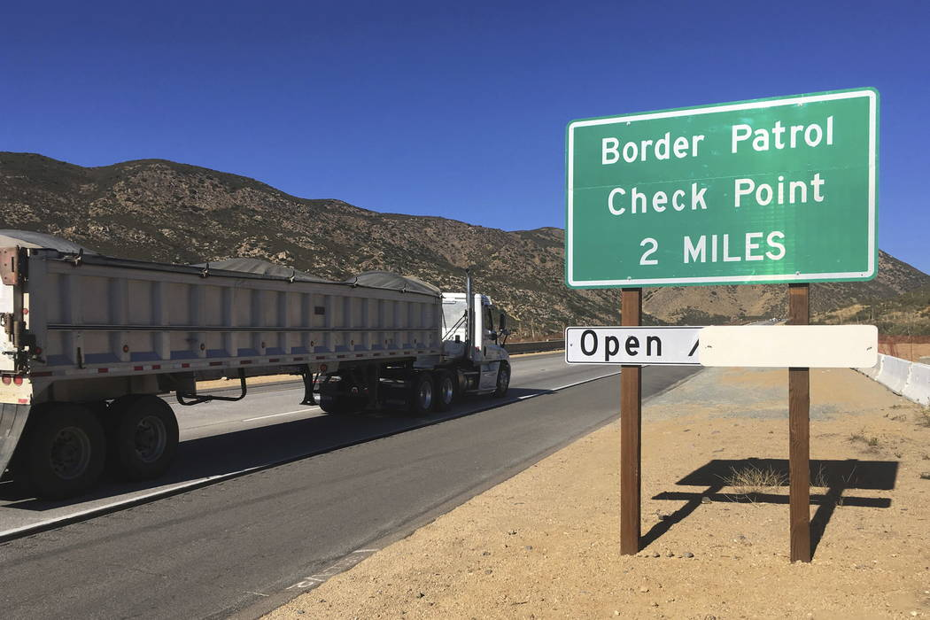 A sign warns of the upcoming California Pine Valley checkpoint, on the main route from Arizona to San Diego. (Elliot Spagat/AP Photo)