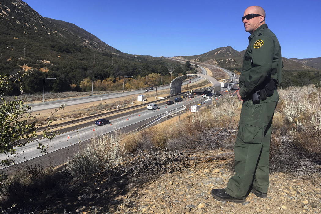 Border Patrol agent Troy Hunt looks over California's Pine Valley checkpoint, on the main route from Arizona to San Diego. (Elliot Spagat/AP Photo)