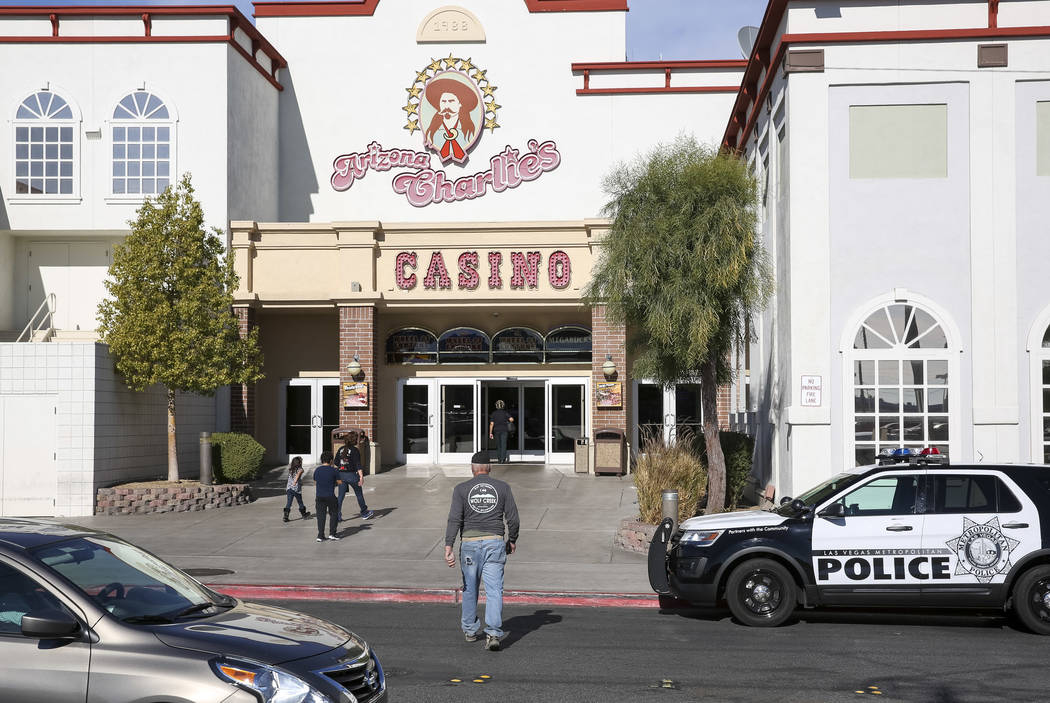 Crime Scene Investigators and Metro detectives are investigating after two security guards were killed in a hotel room at Arizona Charlie's Decatur hotel-casino in Las Vegas Saturday, Dec.  ...