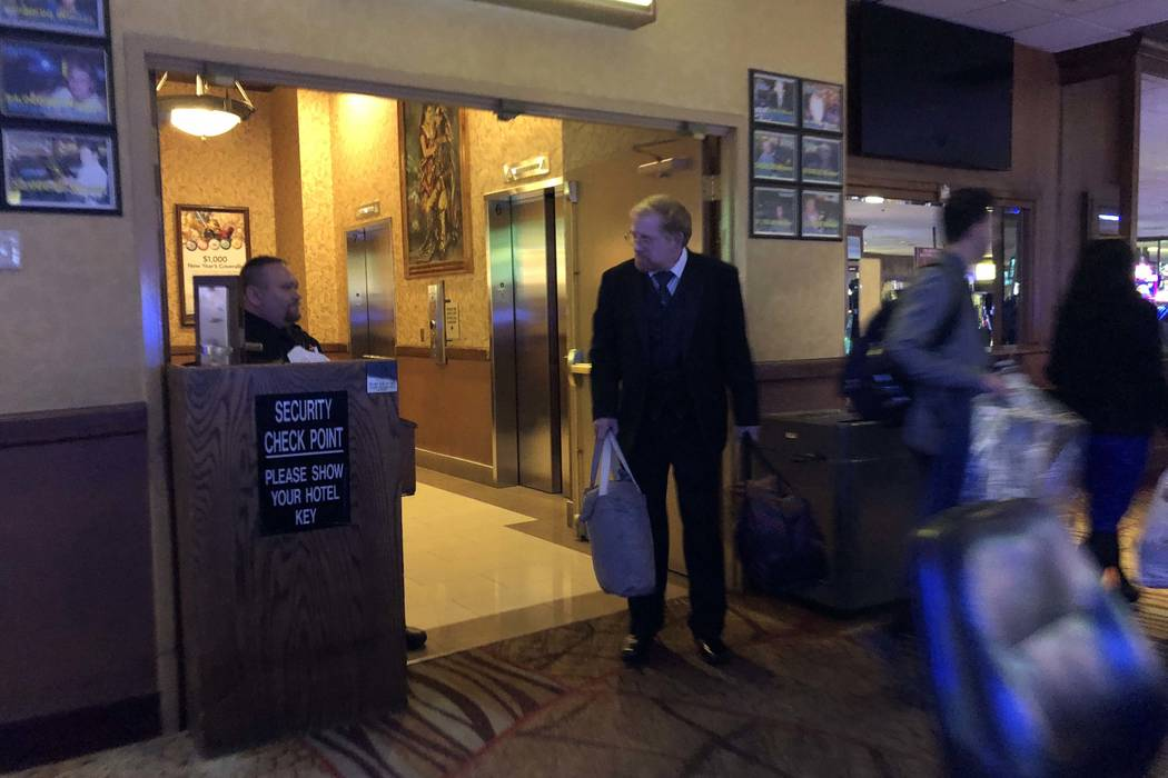 A security guard is stationed at the Klondike Tower hotel rooms at Arizona Charlie's Decatur in Las Vegas Saturday, Dec. 30, 2017. Two security guards were killed in a hotel room earlier Saturda ...