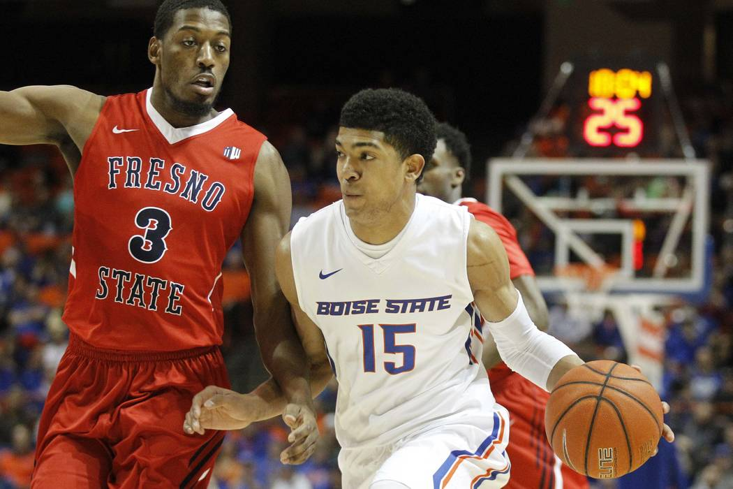 Boise State's Chandler Hutchison (15) moves the ball past Fresno State's Paul Watson (3) during the first half of an NCAA college basketball game in Boise, Idaho, Tuesday, Feb. 28, 2017. (Otto Kit ...