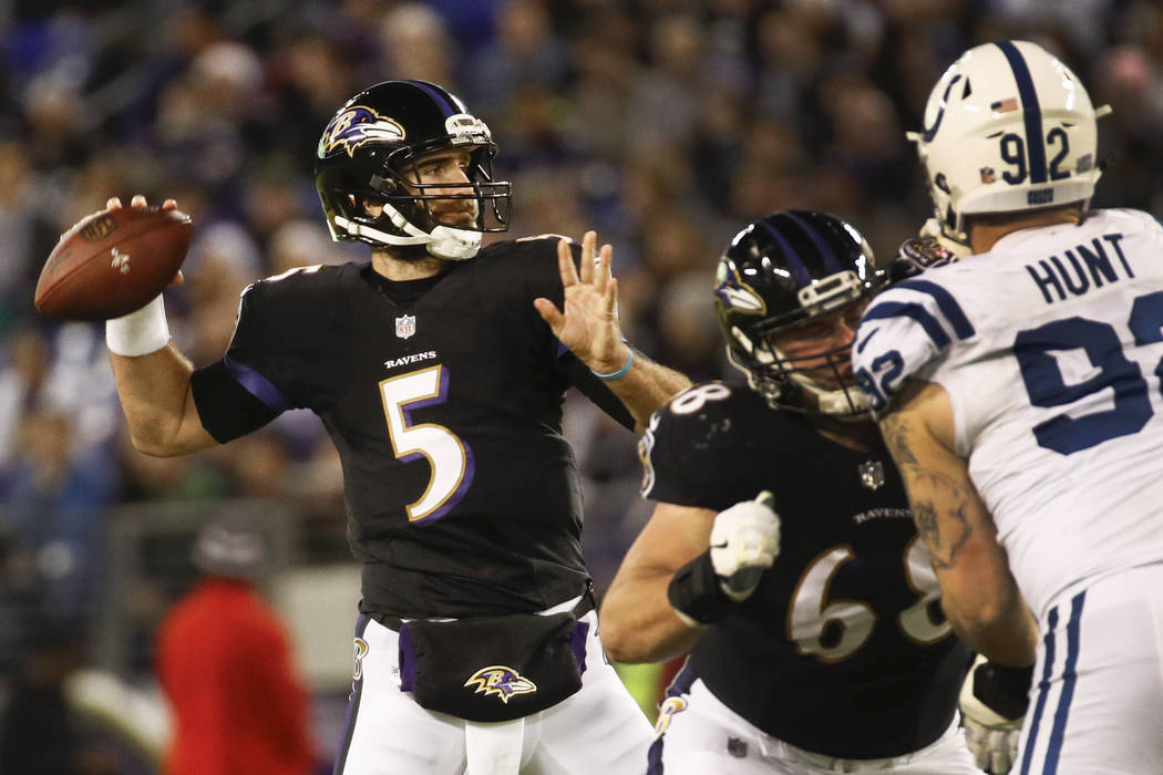 Baltimore Ravens quarterback Joe Flacco (5) passes the ball during the first half of an NFL football game against Indianapolis Colts in Baltimore, Saturday, Dec 23, 2017. (AP Photo/Patrick Semansky)