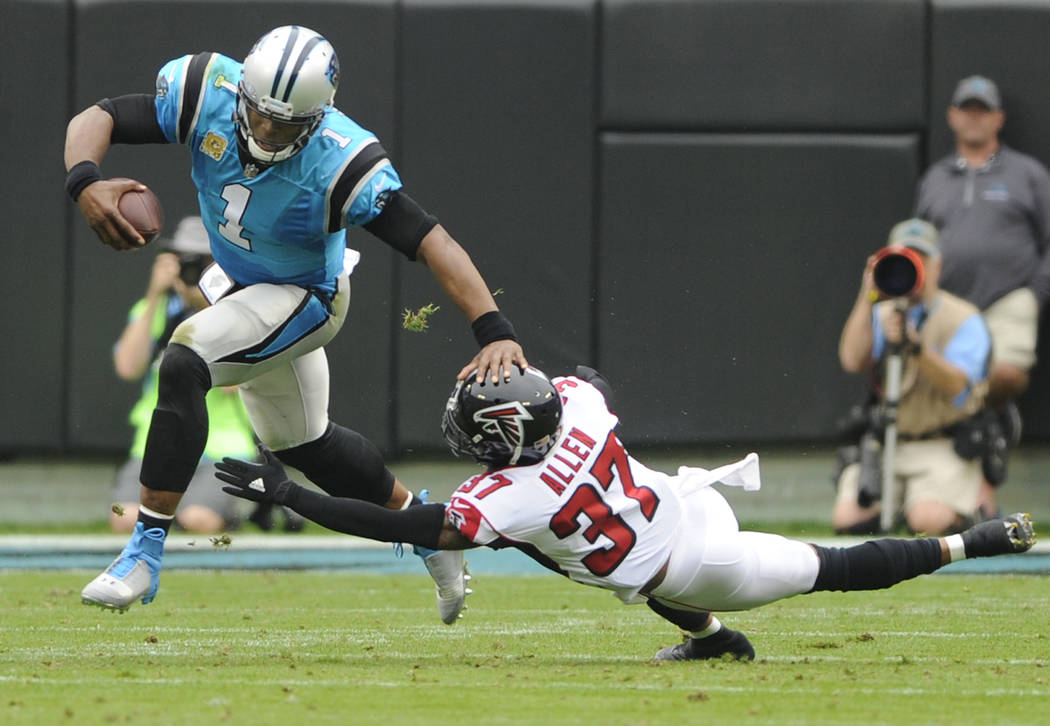 Carolina Panthers' Cam Newton (1) runs past Atlanta Falcons' Ricardo Allen (37) in the first half of an NFL football game in Charlotte, N.C., Sunday, Nov. 5, 2017. (AP Photo/Mike McCarn)