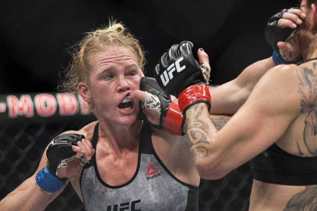 "Cris ""Cyborg"" Justino, right, lands a hand against Holly Holm in the UFC 219 women's featherweight title bout at T-Mobile Arena in Las Vegas, Saturday, Dec. 30, 2017. Just ..."