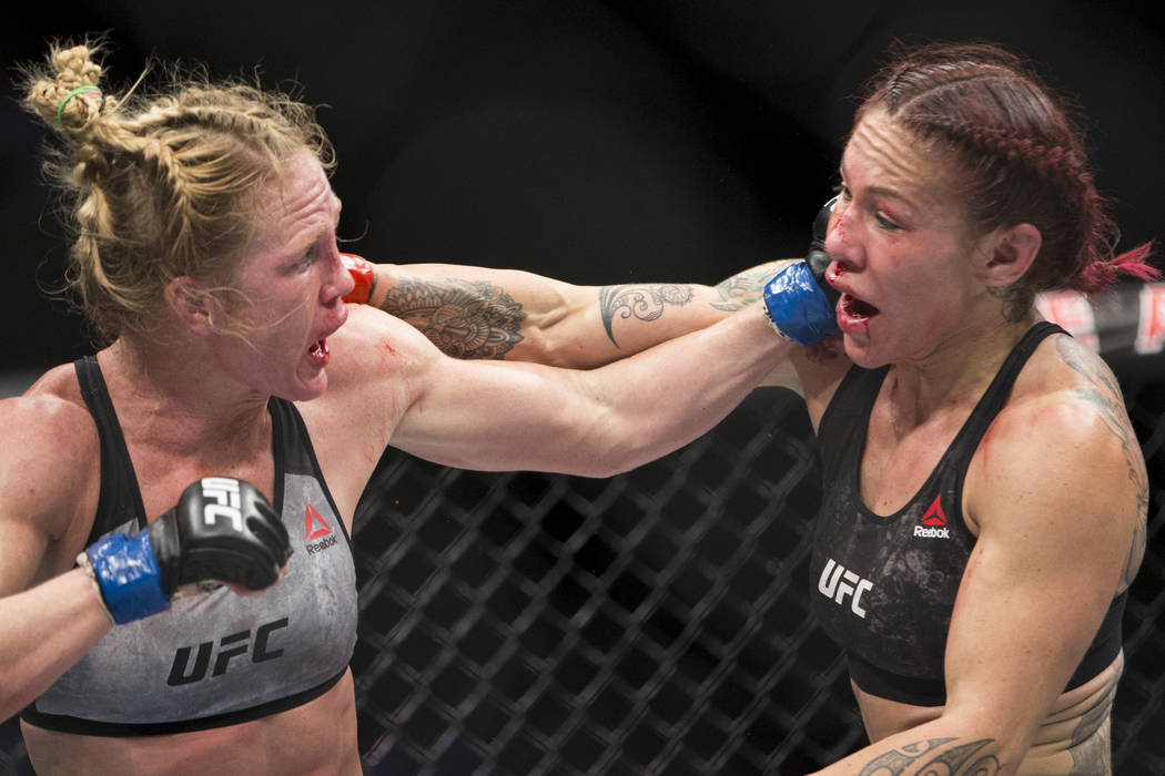 "Holly Holm, left, battle Cris ""Cyborg"" Justino in the UFC 219 women's featherweight title bout at T-Mobile Arena in Las Vegas, Saturday, Dec. 30, 2017. Justino won by unan ..."
