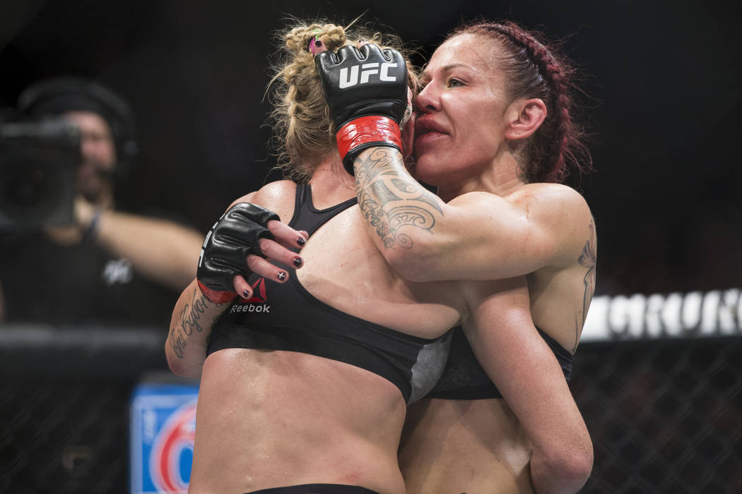"Holly Holm, left, embraces Cris ""Cyborg"" Justino at the end of the UFC 219 women's featherweight title bout at T-Mobile Arena in Las Vegas, Saturday, Dec. 30, 2017. Justin ..."