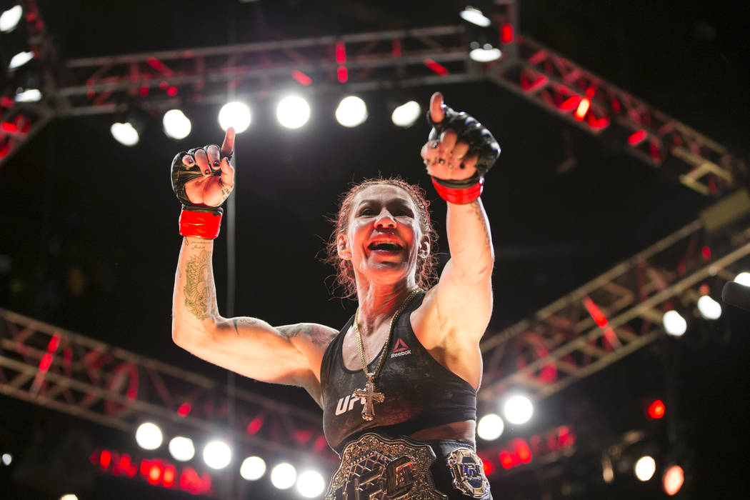 "Cris ""Cyborg"" Justino celebrates her win against Holly Holm in the UFC 219 women's featherweight title bout at T-Mobile Arena in Las Vegas, Saturday, Dec. 30, 2017. Justin ..."