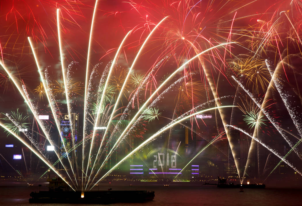 Fireworks explode over the Victoria Harbor during New Year's Eve to celebrate the start of year 2018 in Hong Kong, Monday, Jan. 1, 2018. (Kin Cheung/AP Photo)