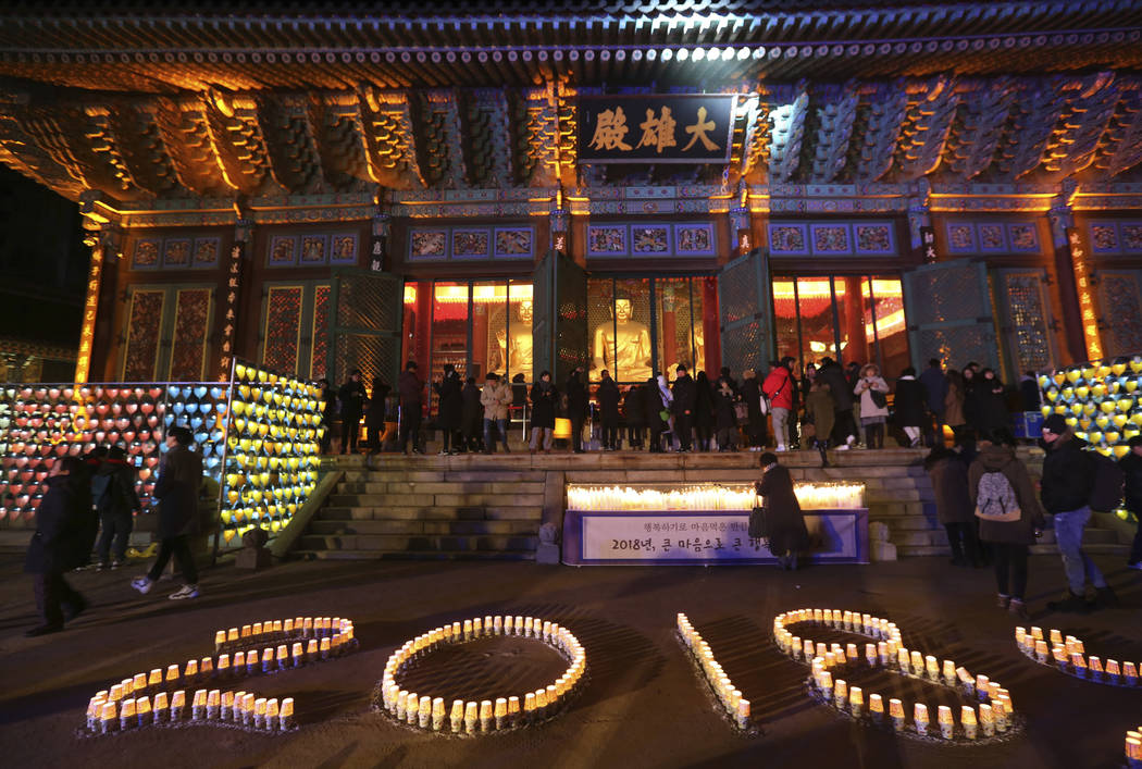 Buddhists light candles during New Year celebrations at Jogyesa Buddhist temple in Seoul, South Korea, Monday, Jan. 1, 2018. (Ahn Young-joon/AP Photo)