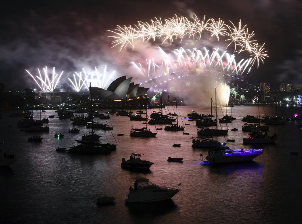 Fireworks explode over Sydney Harbour during New Year's Eve celebrations in Sydney, Monday, Jan. 1, 2018. (David Moir/AP)