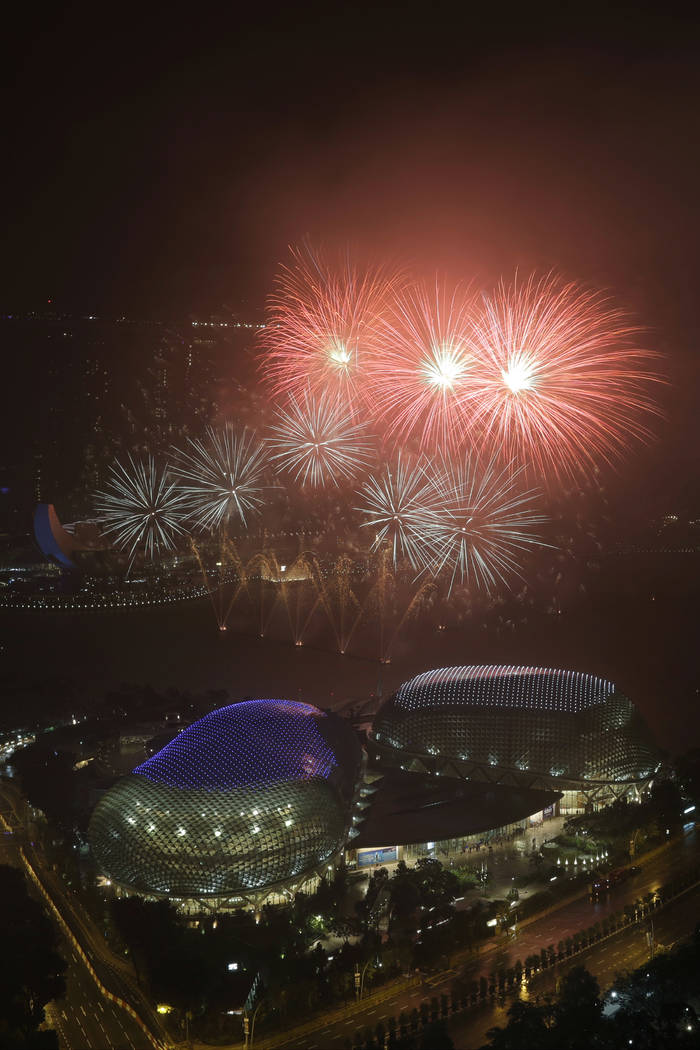 Fireworks explode above Singapore's Esplanade Theaters on the Bay at the stroke of midnight to mark the New Year's celebrations on Monday, Jan. 1, 2018, in Singapore. (Wong Maye-E/AP Photo)