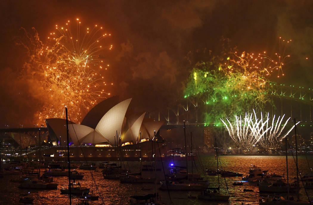 Fireworks explode over Sydney Harbour during New Year's Eve celebrations in Sydney, Australia, Sunday, Dec. 31, 2017. (David Moir/AP)
