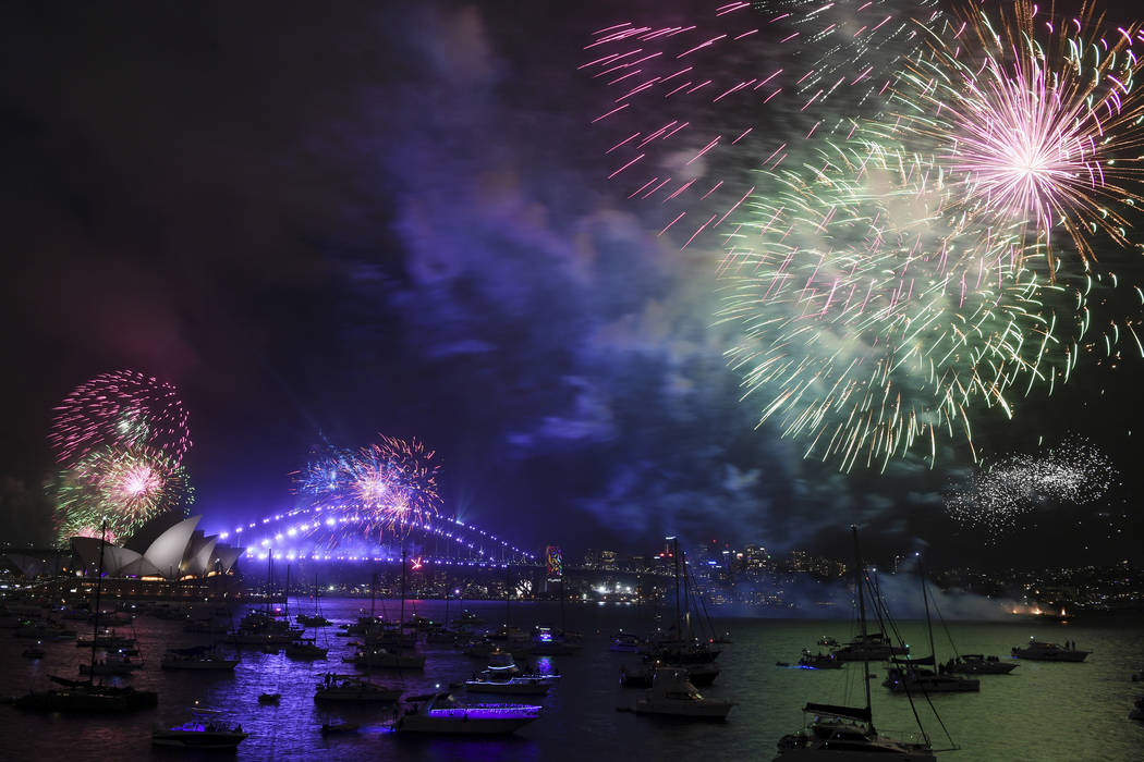Fireworks explode over Sydney Harbour during New Year's Eve celebrations in Sydney, Sunday, Dec. 31, 2017. (David Moir/AP)