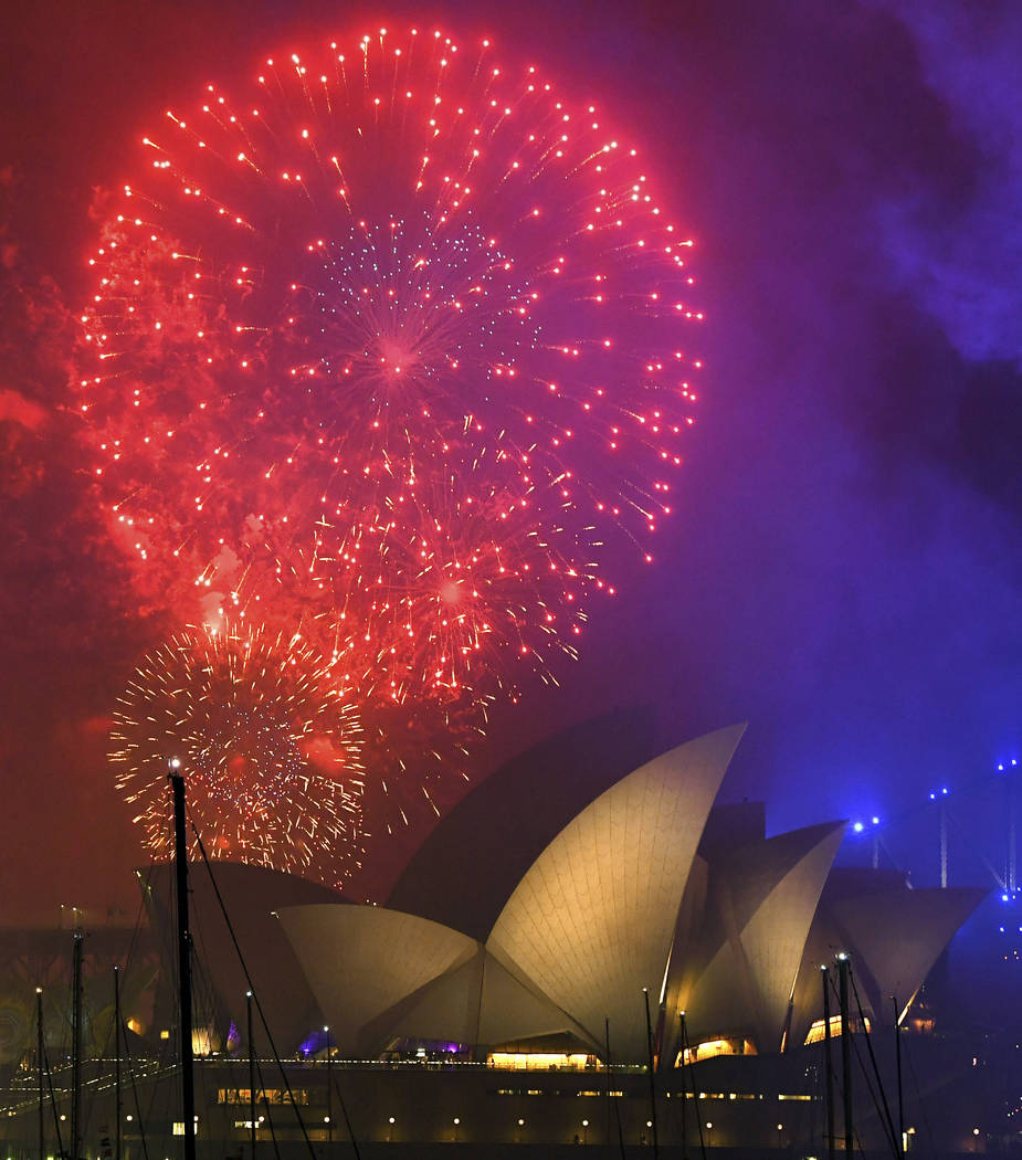 Fireworks explode over the Opera House during New Year's Eve celebrations in Sydney, Australia, Sunday, Dec. 31, 2017. (David Moir/AP)