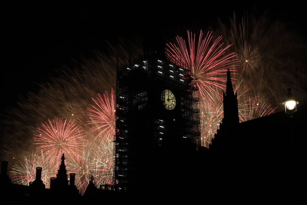 """Fireworks explode over the River Thames behind the Elizabeth Tower which contains the bell know as """"Big Ben"""", at the Houses of Parliament in London, as New Year's celebrations ta ..."""