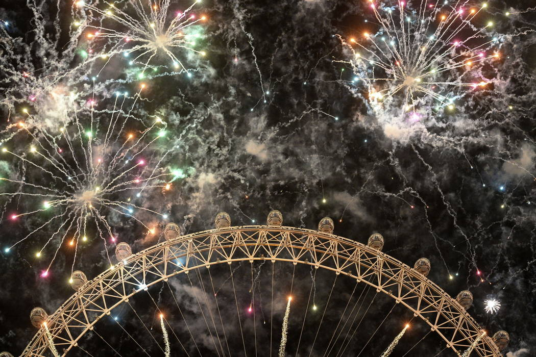 Fireworks light up the sky over the London Eye in central London during the New Year celebrations, Monday Jan. 1, 2018. (John Stillwell/PA via AP)