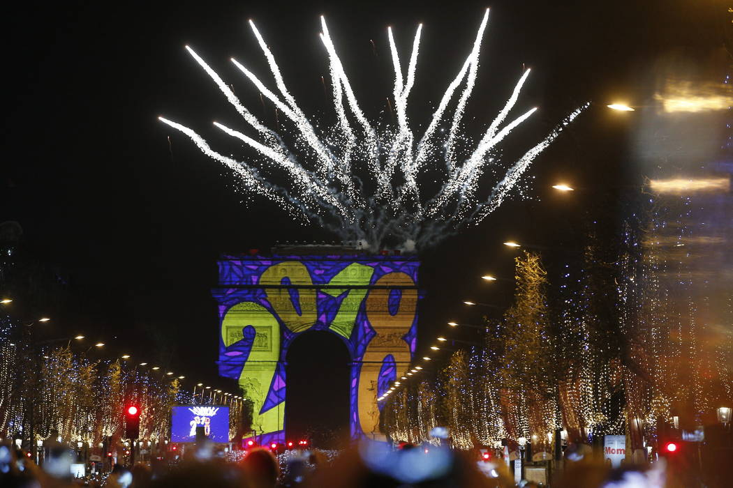 A firework explodes over the Arc de Triomphe as part of the New Year celebrations on the Champs Elysees, in Paris, France, Monday, Jan. 1, 2018. (AP Photo/Thibault Camus)