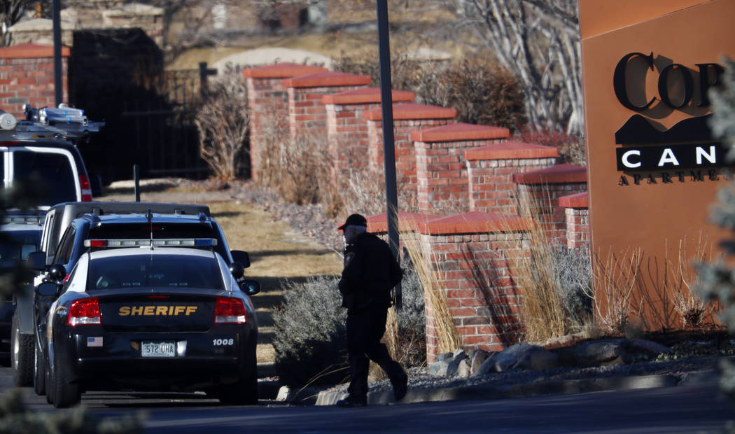 An investigator heads to the scene of shooting Sunday, Dec. 31, 2017, in Highlands Ranch, Colo.  (David Zalubowski/AP Photo)