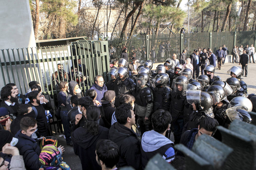 In this photo taken by an individual not employed by the Associated Press and obtained by the AP outside Iran, anti-riot Iranian police prevent university students to join other protesters over Ir ...