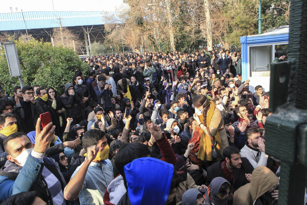 In this photo taken by an individual not employed by the Associated Press and obtained by the AP outside Iran, university students attend a protest inside Tehran University while anti-riot Iranian ...