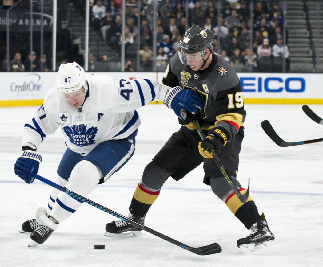 Toronto Maple Leafs center Leo Komarov (47) holds Vegas Golden Knights right ring Reilly Smith (19) back during their game at T-Mobile Arena in Las Vegas on Sunday, December 31, 2017. Daniel Clark ...