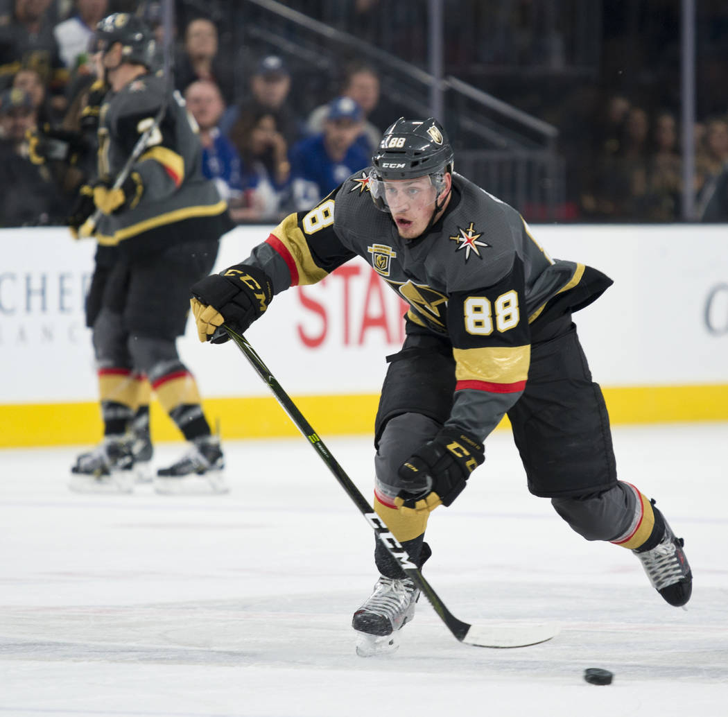 Vegas Golden Knights defenseman Nate Schmidt (88) races up the ice with the puck during their home game against the Toronto Maple Leafs at T-Mobile Arena in Las Vegas on Sunday, December 31, 2017. ...