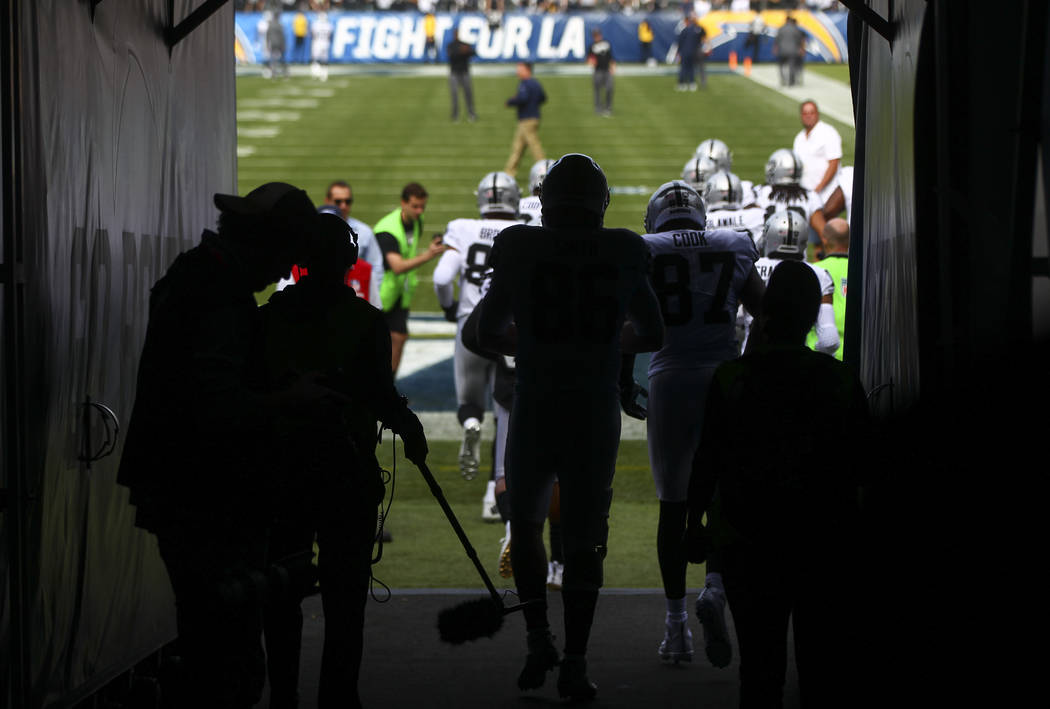 Oakland Raiders players take the field to warm up before playing the Los Angeles Chargers in an NFL game at StubHub Center in Carson, Calif. on Sunday, Dec. 31, 2017. (Chase Stevens/Las Vegas Revi ...