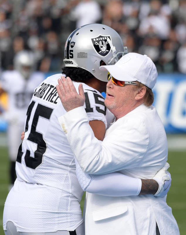 Dec 31, 2017; Carson, CA, USA; Oakland Raiders wide receiver Michael Crabtree (15) talks with owner Mark Davis during an NFL football game against the Los Angeles Chargers at StubHub Center. Manda ...