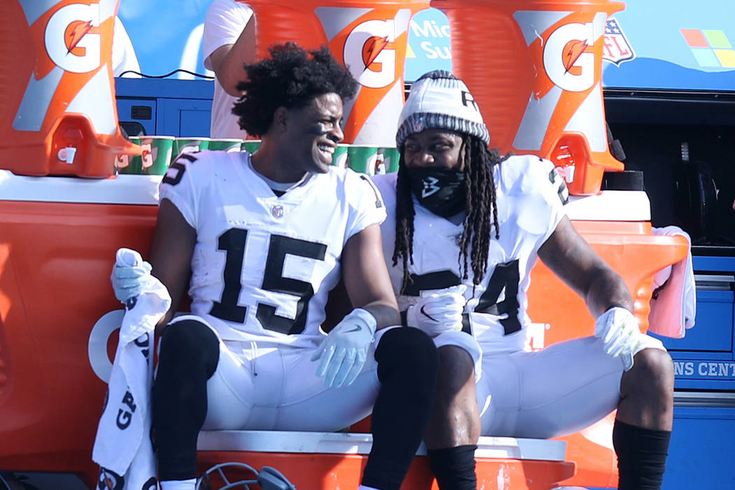 Oakland Raiders wide receiver Michael Crabtree (15) and Oakland Raiders running back Marshawn Lynch (24) share a moment on the sideline during the first half of a NFL game against the Los Angeles  ...