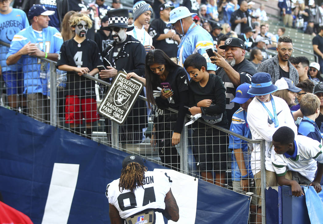 Oakland Raiders wide receiver Cordarrelle Patterson (84) signs items at halftime during an NFL game against the Los Angeles Chargers at StubHub Center in Carson, Calif. on Sunday, Dec. 31, 2017. C ...