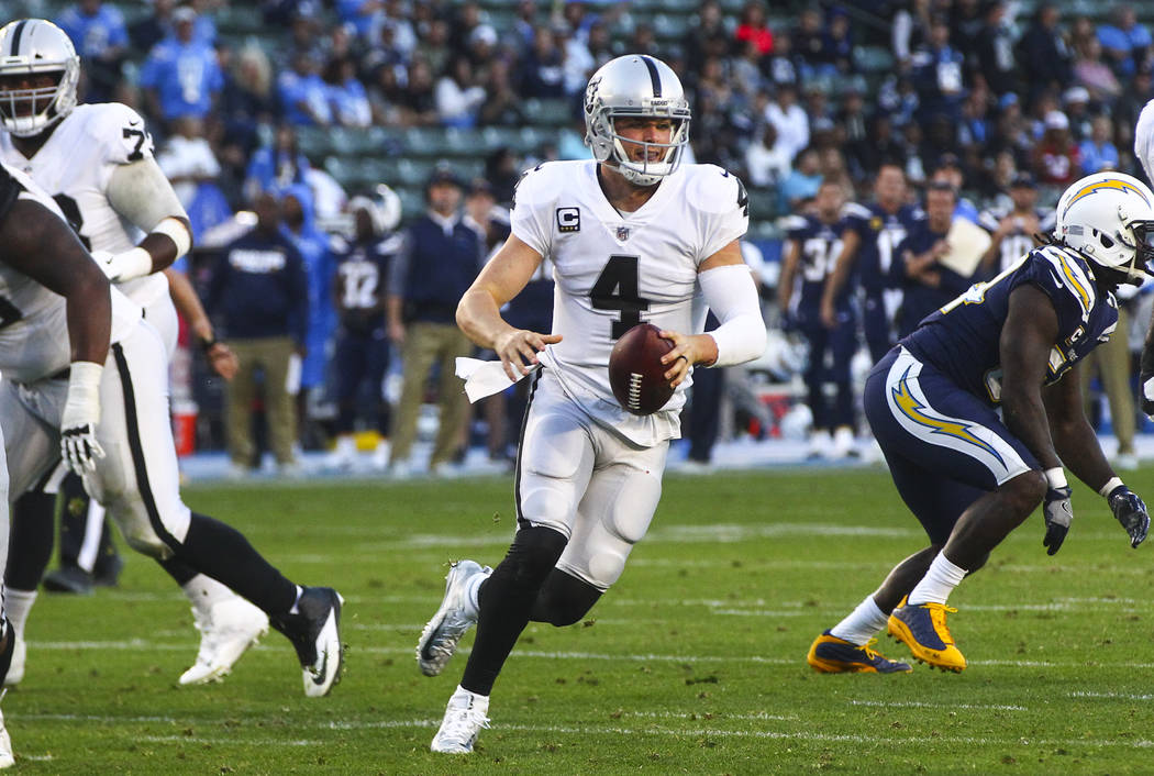 Oakland Raiders quarterback Derek Carr (4) runs the ball against the Los Angeles Chargers during an NFL game at StubHub Center in Carson, Calif. on Sunday, Dec. 31, 2017. Chase Stevens Las Vegas R ...
