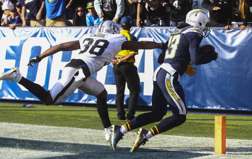 Los Angeles Chargers wide receiver Keenan Allen (13) scores a touchdown past Oakland Raiders cornerback T.J. Carrie (38) during an NFL game at StubHub Center in Carson, Calif. on Sunday, Dec. 31,  ...