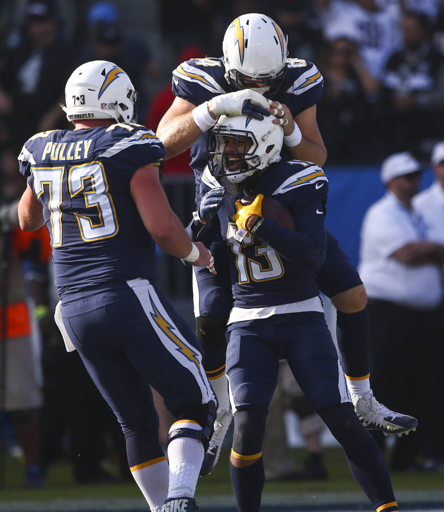 Los Angeles Chargers wide receiver Keenan Allen (13) celebrates his touchdown with Spencer Pulley (73) and Sean McGrath (84) during an NFL game against the Oakland Raiders at StubHub Center in Car ...