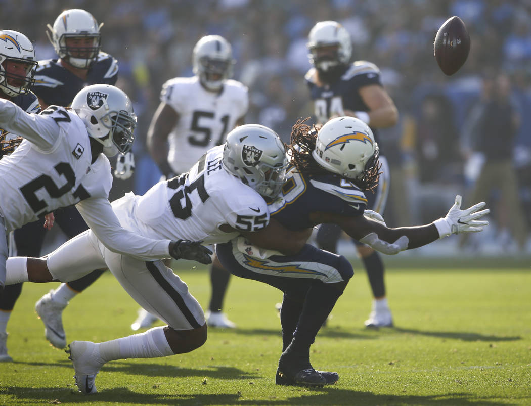 Oakland Raiders middle linebacker Marquel Lee (55) forces Los Angeles Chargers running back Melvin Gordon (28) to fumble during an NFL game at StubHub Center in Carson, Calif. on Sunday, Dec. 31,  ...