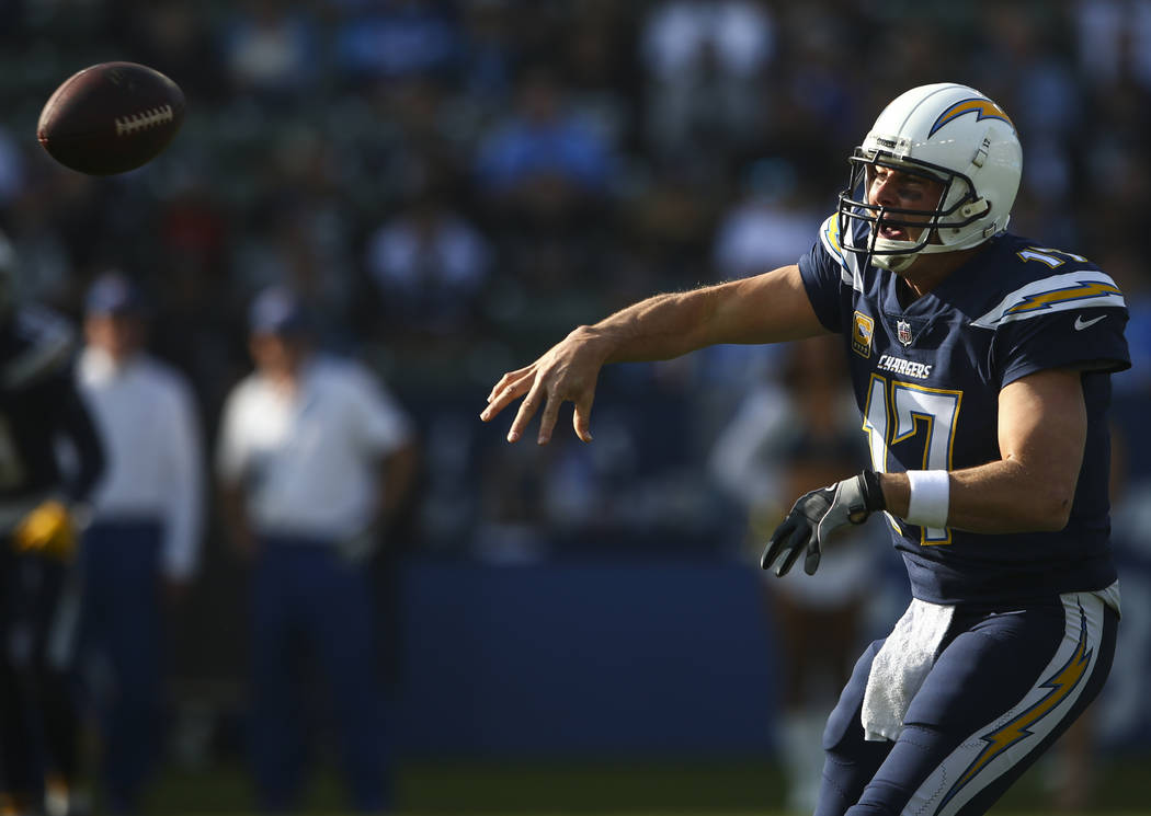 Los Angeles Chargers quarterback Philip Rivers (17) passes the ball during an NFL game against the Oakland Raiders at StubHub Center in Carson, Calif. on Sunday, Dec. 31, 2017. Chase Stevens Las V ...