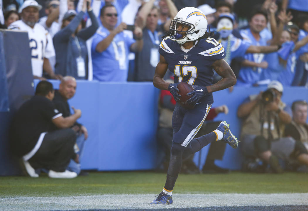 Los Angeles Chargers wide receiver Travis Benjamin (12) scores a touchdown against the Oakland Raiders during an NFL game at StubHub Center in Carson, Calif. on Sunday, Dec. 31, 2017. Chase Steven ...