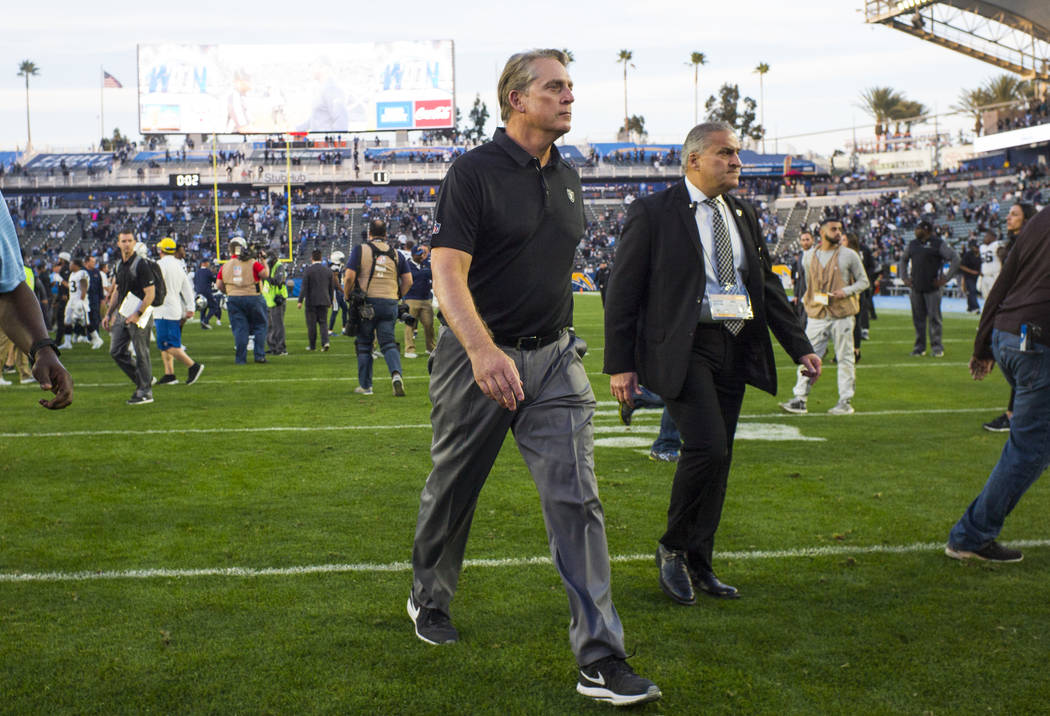 Oakland Raiders head coach Jack Del Rio walks off the field after his final game as head coach after losing 30-10 to the Los Angeles Chargers in an NFL game at StubHub Center in Carson, Calif. on  ...