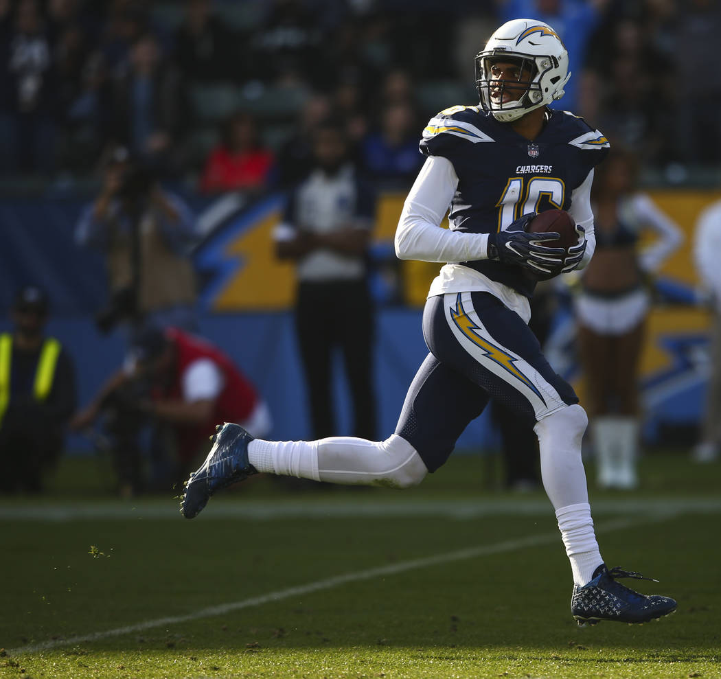 Los Angeles Chargers wide receiver Tyrell Williams (16) runs the ball for a touchdown against the Oakland Raiders during an NFL game at StubHub Center in Carson, Calif. on Sunday, Dec. 31, 2017. C ...