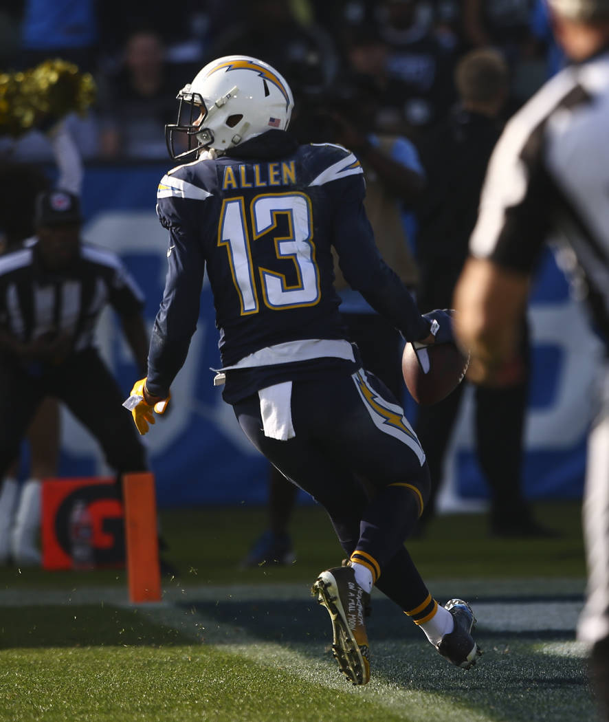 Los Angeles Chargers wide receiver Keenan Allen (13) scores a touchdown against the Oakland Raiders during an NFL game at StubHub Center in Carson, Calif. on Sunday, Dec. 31, 2017. Chase Stevens L ...