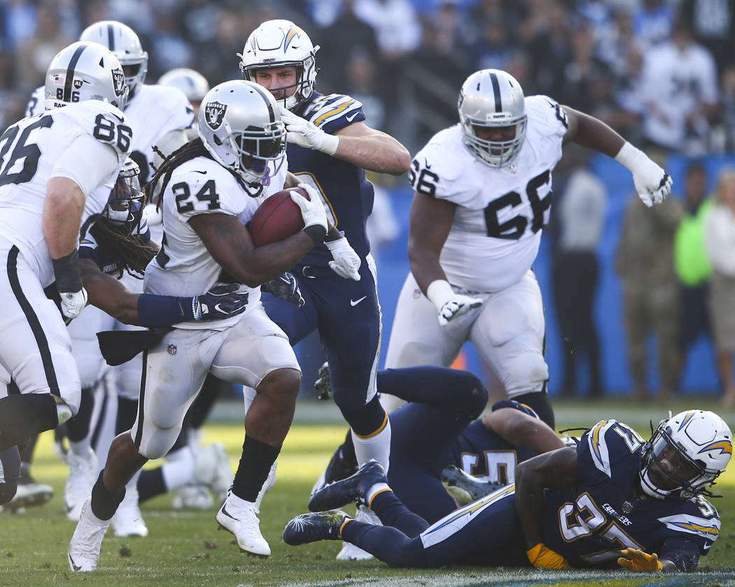 Oakland Raiders running back Marshawn Lynch (24) runs the ball against the Los Angeles Chargers during an NFL game at StubHub Center in Carson, Calif. on Sunday, Dec. 31, 2017. Chase Stevens Las V ...
