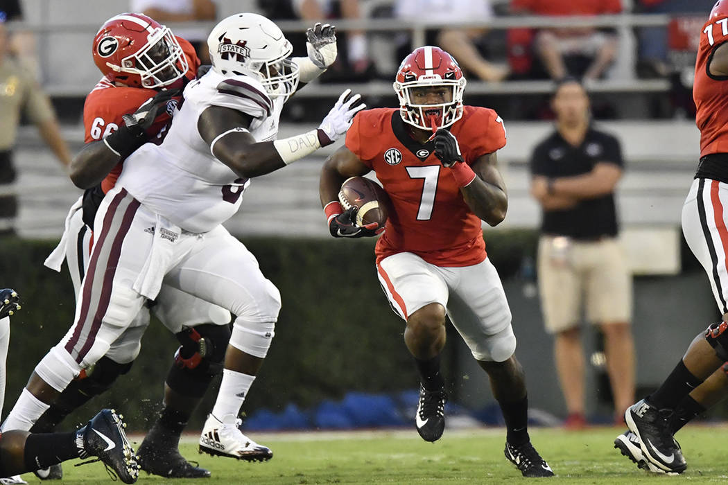 Georgia running back D'Andre Swift (7) runs against Mississippi State during the first of an NCAA college football game, Saturday, Sept. 23, 2017, in Athens, Ga. (AP Photo/Mike Stewart)