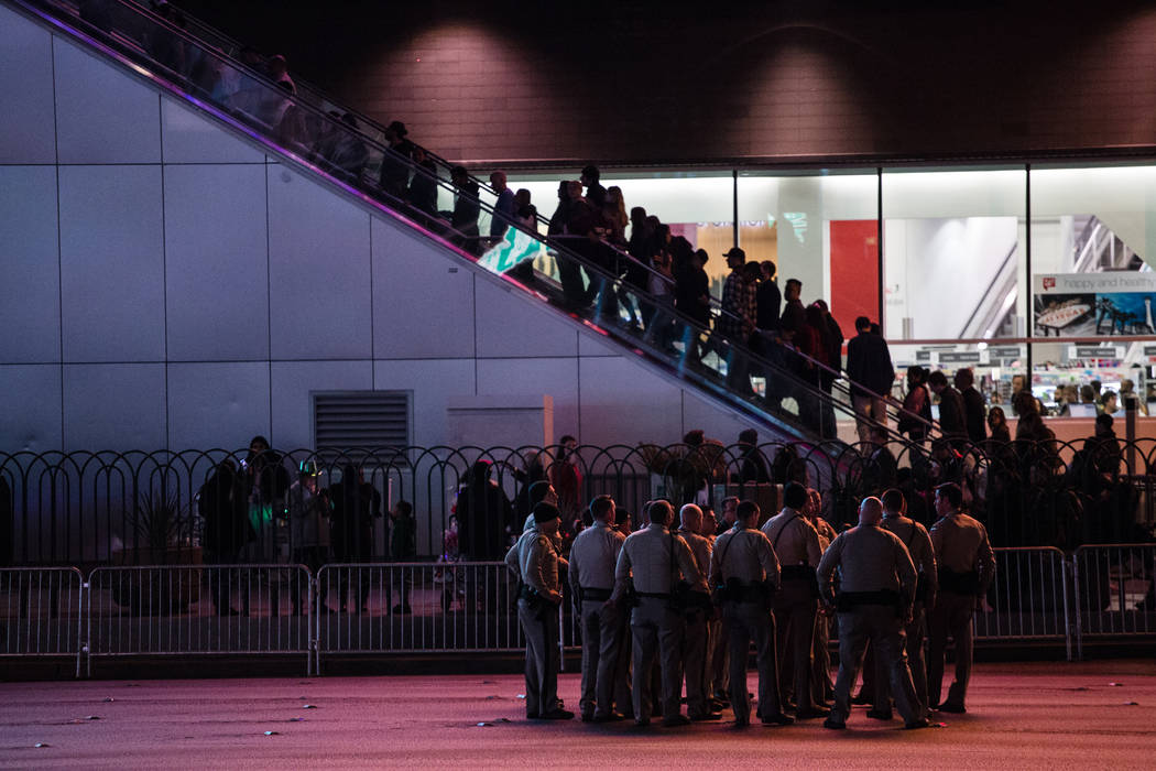 Police officers huddle along the Strip on New Year's Eve in Las Vegas, Sunday, Dec. 31, 2017. Joel Angel Juarez Las Vegas Review-Journal @jajuarezphoto