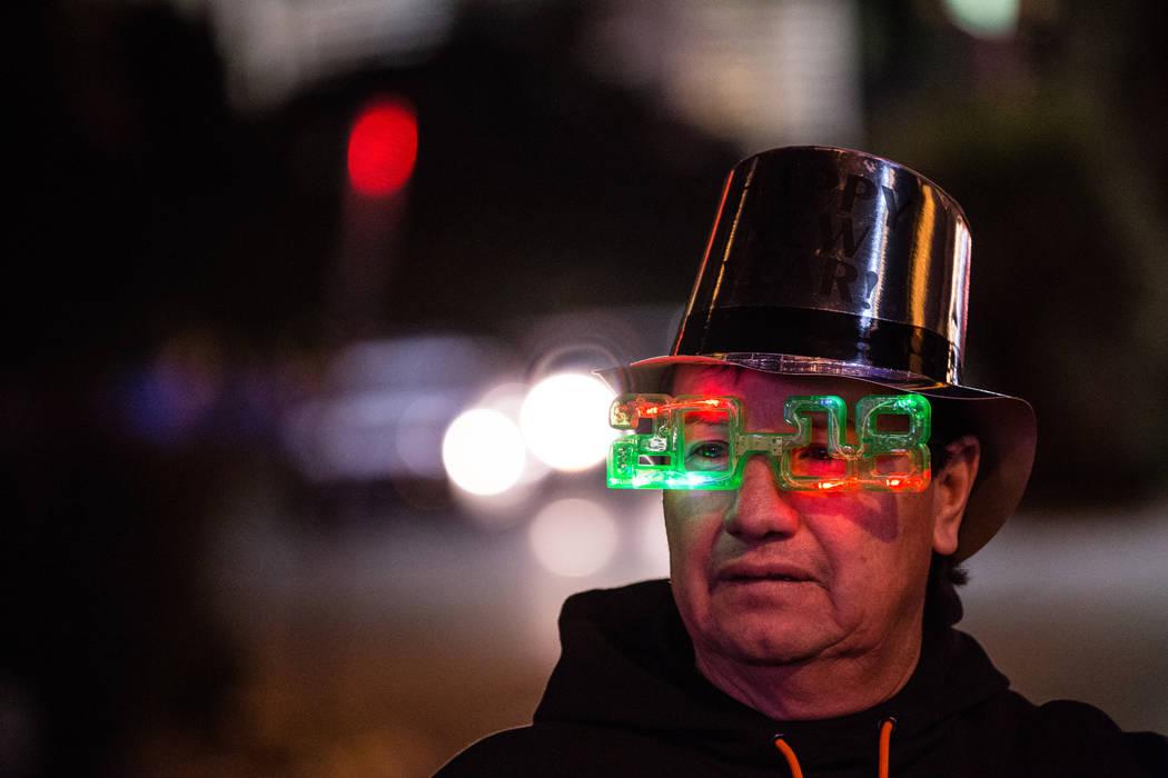 Helder Del Valle of San Francisco, 54, stands along the Strip on New Year's Eve in Las Vegas, Sunday, Dec. 31, 2017. Joel Angel Juarez Las Vegas Review-Journal @jajuarezphoto